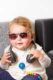 Funny baby with headphones Stock Image