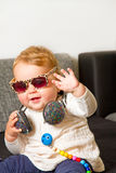 Funny baby with headphones Stock Images