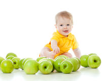 Funny baby with healthy food apples Stock Photos