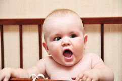 Funny baby in her bad Royalty Free Stock Photos