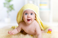 Funny baby kid under a hooded towel after bath stock images