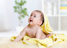 Funny baby kid under a hooded towel after bath Stock Image