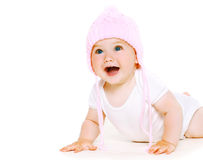 Funny baby in knitted hat. Playing stock photo