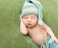 Funny baby in knitted hat sleeping with opened mouth Royalty Free Stock Image