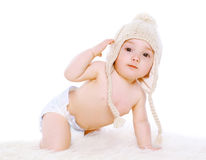 Funny baby in knitted winter hat Royalty Free Stock Photo