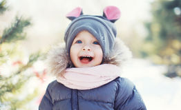 Funny baby laughing outdoors in winter Royalty Free Stock Photography