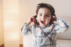 Funny baby listening music on headphones Stock Photos