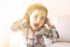 Funny baby listening music on headphones Royalty Free Stock Photo