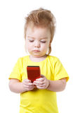 Funny baby looks at the screen of the smartphone Royalty Free Stock Photo