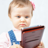 Funny baby make selfie on mobile phone Royalty Free Stock Image