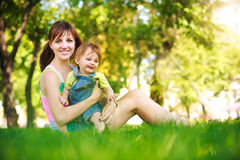 Funny baby with mom in  park Royalty Free Stock Photography