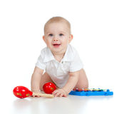 Funny baby with musical toys Royalty Free Stock Image