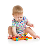 Funny baby musician playing Royalty Free Stock Images