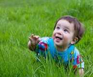Funny baby outdoor. Funny baby on the green grass Royalty Free Stock Photo