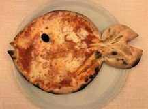 Funny baby pizza `Margherita` in the form of fish royalty free stock images