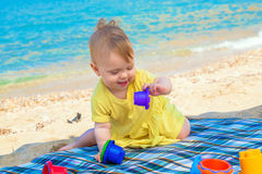 Funny baby playing at the beach. Royalty Free Stock Photos
