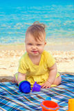 Funny baby playing at the beach. Stock Photography