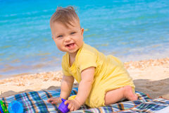 Funny baby playing at the beach. Royalty Free Stock Photo