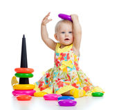 Funny baby playing with color developmental toy Stock Images