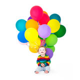 Funny baby playing with colorful balloons Royalty Free Stock Photography