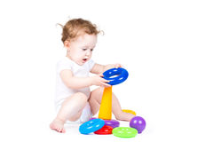 Funny baby playing with a colorful pyramid Royalty Free Stock Image