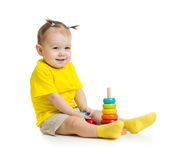 Funny baby playing with colorful wood pyramid Stock Photos