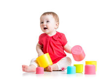 Funny baby playing with colourful cup toys Royalty Free Stock Photography