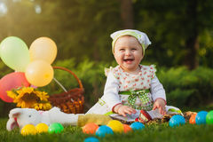 Funny baby is playing on the green grass Stock Images