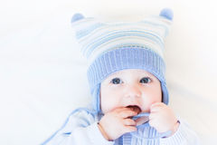 Funny baby playing with its hat Royalty Free Stock Photo
