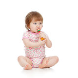 Funny baby playing musical toy Stock Photography