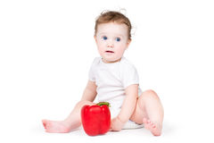 Funny baby playing with a red paprika Royalty Free Stock Photography