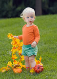Funny baby with pumpkins halloween Stock Image