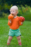 Funny baby with pumpkins halloween Royalty Free Stock Images