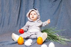 Funny baby in rabbit costume. Baby in rabbit costume and with Easter eggs stock images