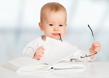 Funny Baby Reading A Book Stock Photos