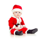 Funny baby in Santa Claus clothes Stock Photography