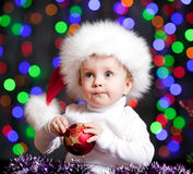 Funny baby in Santa Claus hat Royalty Free Stock Photos