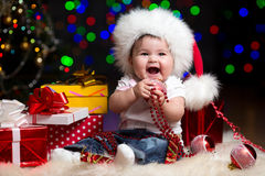 Funny baby in Santa Claus hat Royalty Free Stock Photo