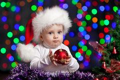 Funny baby in Santa hat on bright background Stock Photography