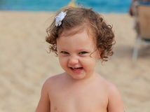 Funny baby smiling on the beach Stock Photos