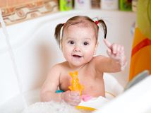 Funny baby smiling while taking a bath Royalty Free Stock Photos