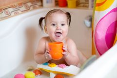Funny baby smiling while taking a bath Royalty Free Stock Photo