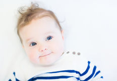 Funny baby in a striped navy shirt. Funny little baby in a striped navy shirt royalty free stock photos
