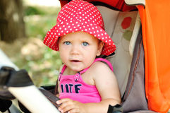 Funny baby in stroller Royalty Free Stock Images