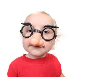 Funny Baby Toddler Boy Wearing a Humorous Mask i Stock Photos