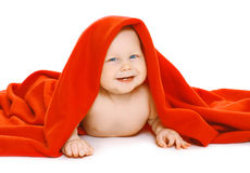 Funny baby under the red towel Stock Image
