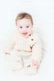 Funny baby in a warm cable knit sweater and boots Royalty Free Stock Photo