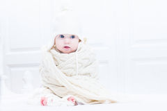 Funny baby wearing a warm knitted scarf and hat Royalty Free Stock Images