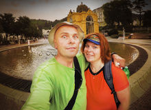 Funny backpackers couple. Stock Photo