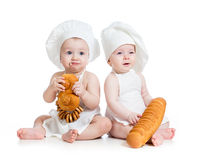 Funny bakers babies boy and girl. Funny bakers kids boy and girl Stock Images